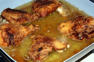 frying chicken in an electric skillet