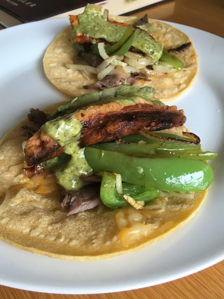 soft tacos with skirt steak, sweet potato and Peruvian green sauce