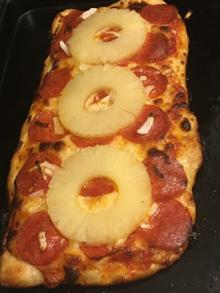 pizza with pepperoni and pineapple